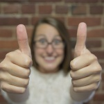 Small business owner happy about her inbound marketing ROI